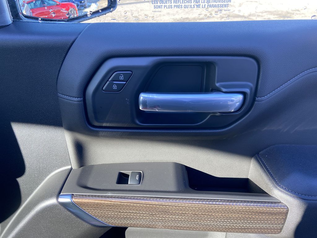 Red[Cherry Red Tintcoat] 2021 Chevrolet Silverado 1500 RST Passenger Front Door Controls Photo in Calgary AB