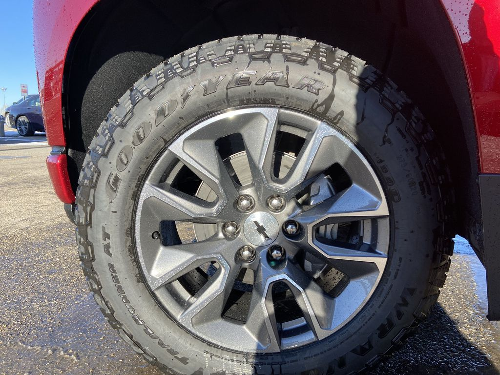 Red[Cherry Red Tintcoat] 2021 Chevrolet Silverado 1500 RST Left Front Rim and Tire Photo in Calgary AB