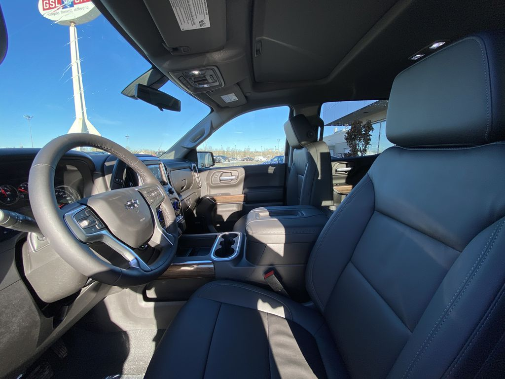 Red[Cherry Red Tintcoat] 2021 Chevrolet Silverado 1500 RST Left Front Interior Photo in Calgary AB