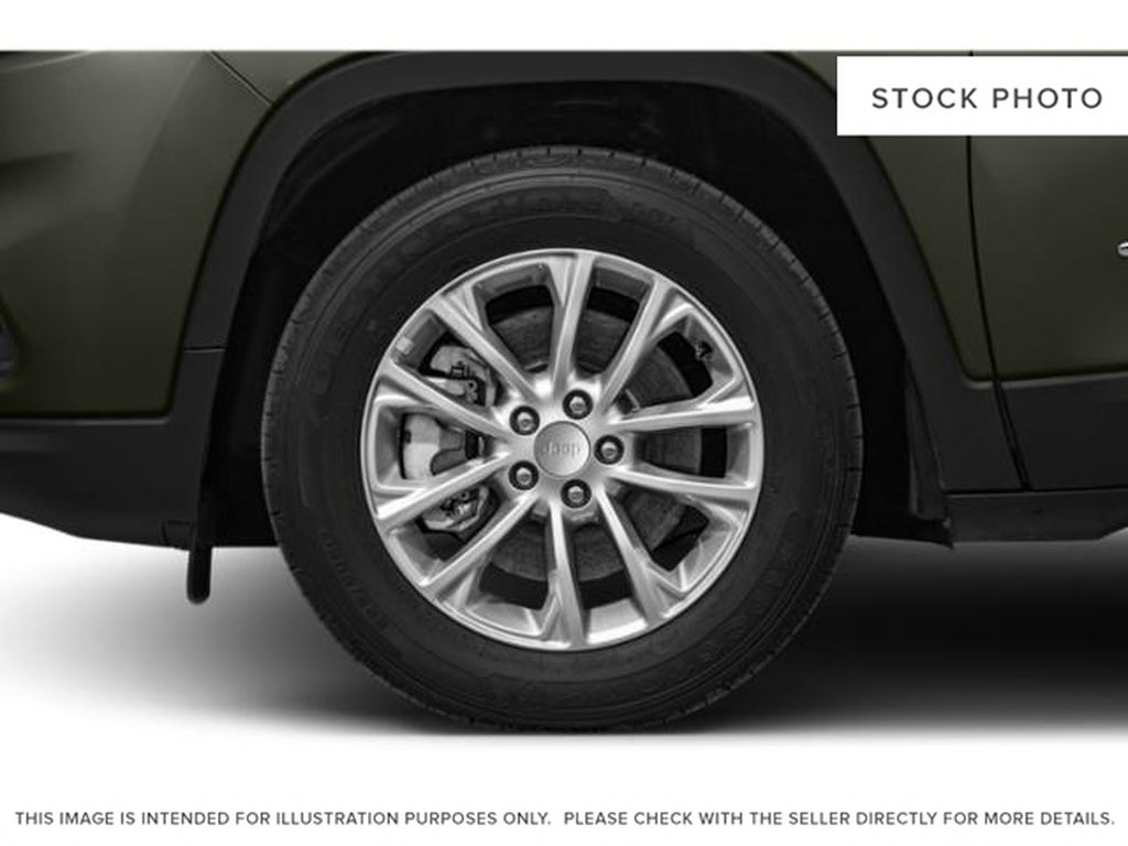 White[Bright White] 2021 Jeep Cherokee Left Front Rim and Tire Photo in Yarmouth NS