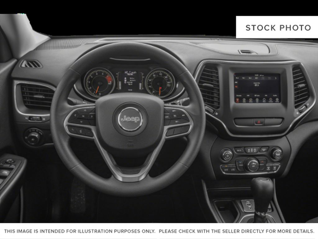 White[Bright White] 2021 Jeep Cherokee Steering Wheel and Dash Photo in Yarmouth NS