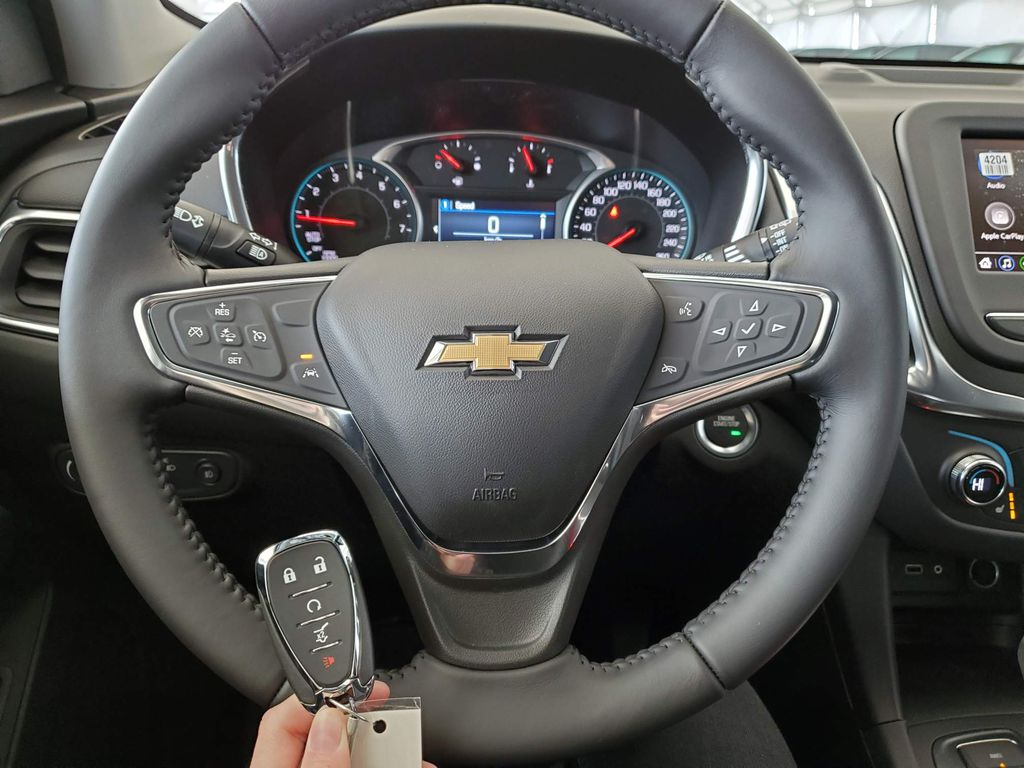 White 2021 Chevrolet Equinox Left Side Photo in Airdrie AB