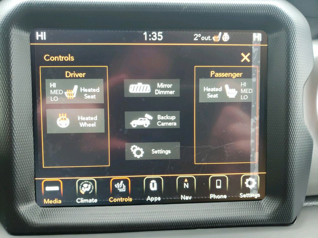 Black 2021 Jeep Wrangler Steering Wheel and Dash Photo in Fort Macleod AB