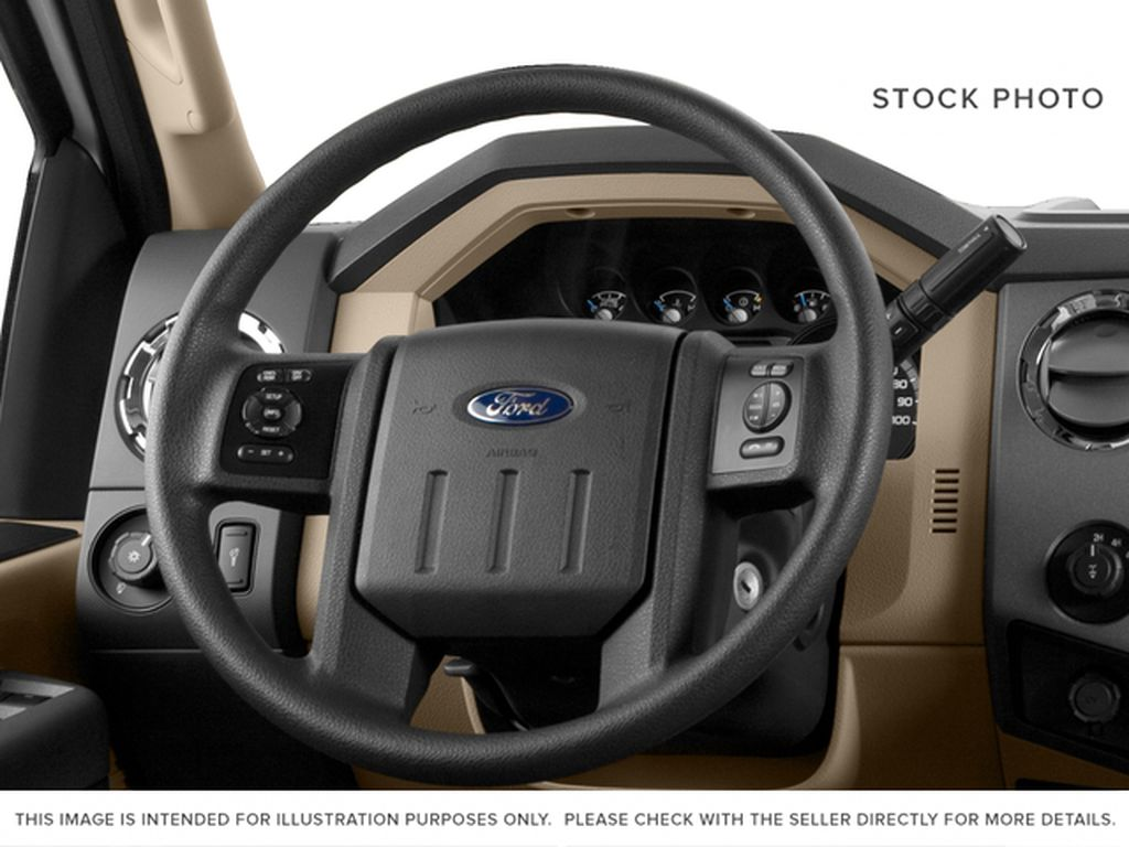 Blue[Blue Jeans Metallic] 2016 Ford Super Duty F-350 SRW Steering Wheel and Dash Photo in Fort Macleod AB
