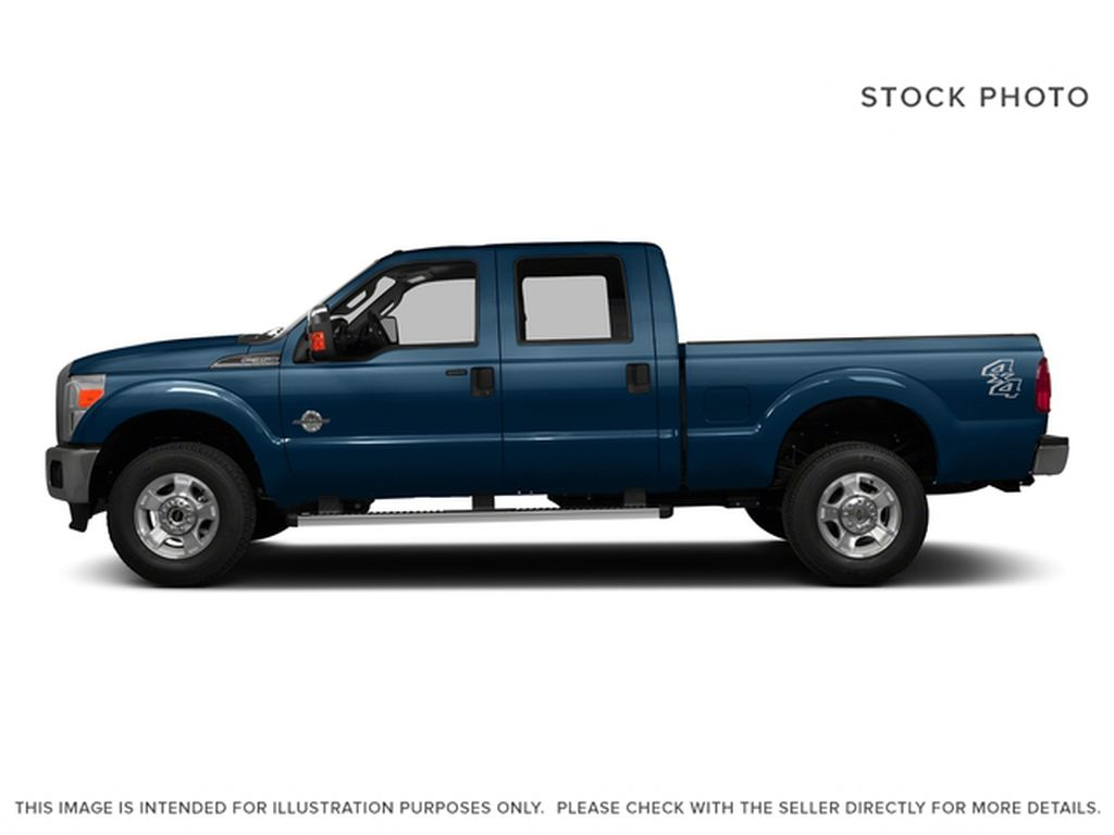 Blue[Blue Jeans Metallic] 2016 Ford Super Duty F-350 SRW Left Side Photo in Fort Macleod AB