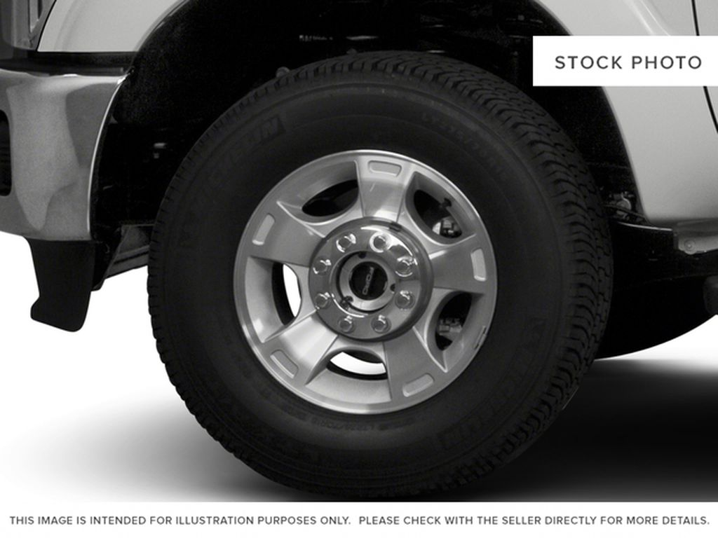 Blue[Blue Jeans Metallic] 2016 Ford Super Duty F-350 SRW Left Front Rim and Tire Photo in Fort Macleod AB
