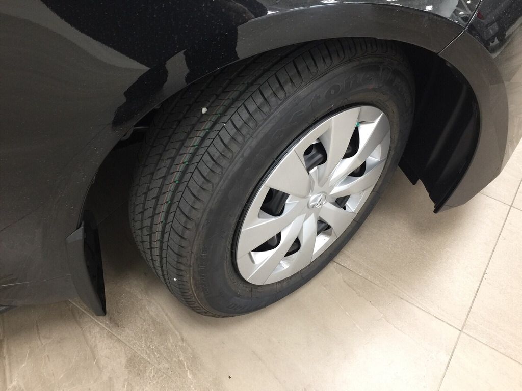 Black[Black Sand Pearl] 2021 Toyota Corolla L Right Front Rim and Tire Photo in Sherwood Park AB