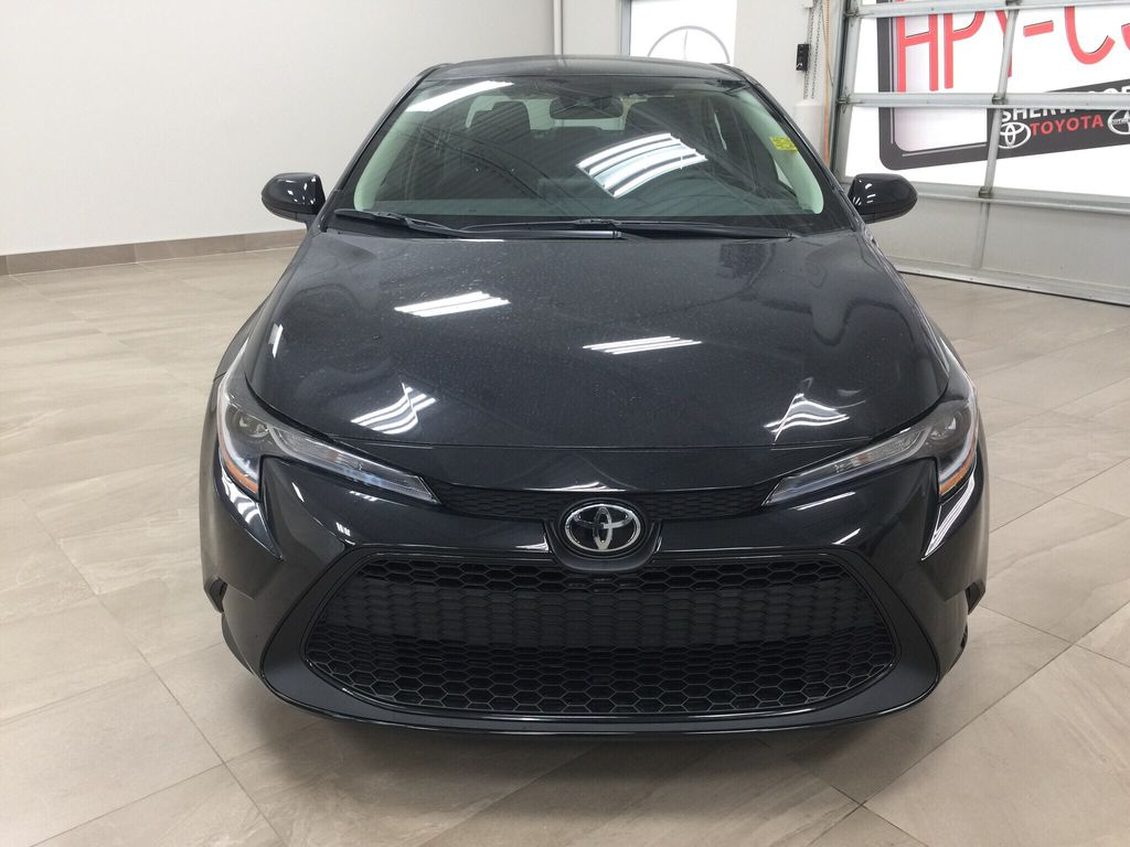 Black[Black Sand Pearl] 2021 Toyota Corolla L Front Vehicle Photo in Sherwood Park AB