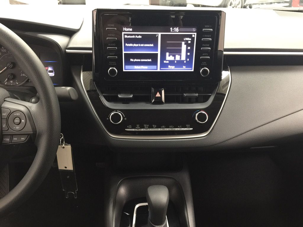Black[Black Sand Pearl] 2021 Toyota Corolla L Central Dash Options Photo in Sherwood Park AB