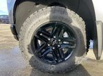 Gray[Satin Steel Metallic] 2021 Chevrolet Silverado 1500 LT Trail Boss Left Front Rim and Tire Photo in Calgary AB