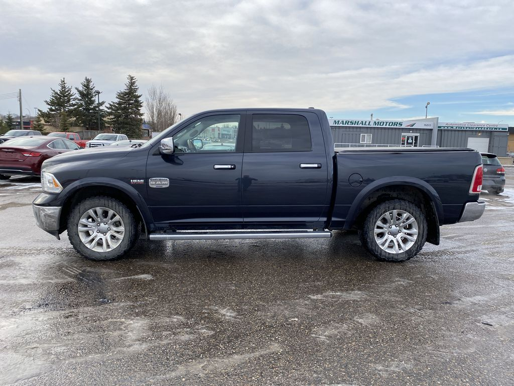 "Gray[Granite Crystal Metallic] 2016 Ram 1500 4WD Crew Cab 140.5"" Longhorn *Heated Seats/Wheel* *Tow Pkg* Left Side Photo in Brandon MB"