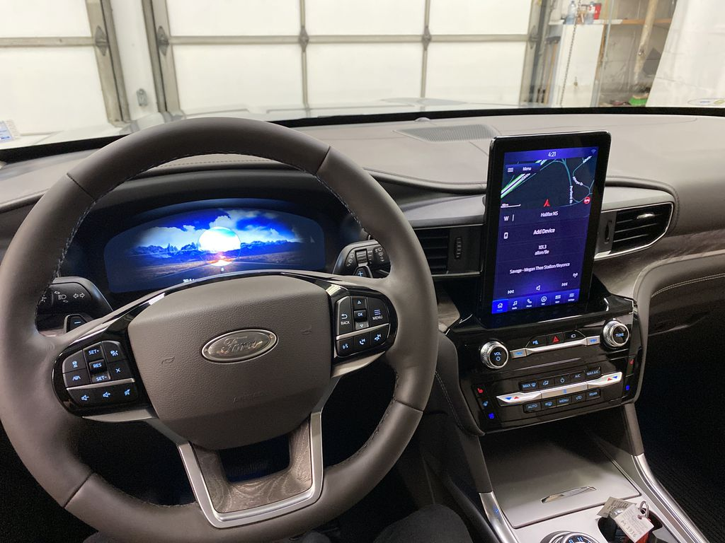 Silver[Iconic Silver Metallic] 2021 Ford Explorer Steering Wheel and Dash Photo in Dartmouth NS