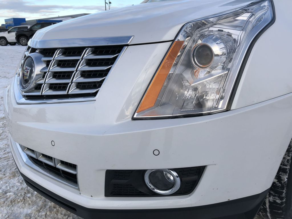 White[Platinum Ice Tricoat] 2015 Cadillac SRX Left Front Head Light / Bumper and Grill in Edmonton AB