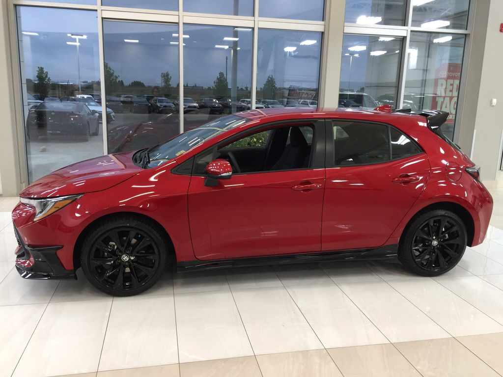 Red[Supersonic Red] 2021 Toyota Corolla Special Edition Hatchback Left Side Photo in Sherwood Park AB
