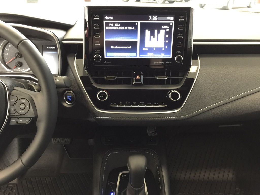 Red[Supersonic Red] 2021 Toyota Corolla Special Edition Hatchback Central Dash Options Photo in Sherwood Park AB