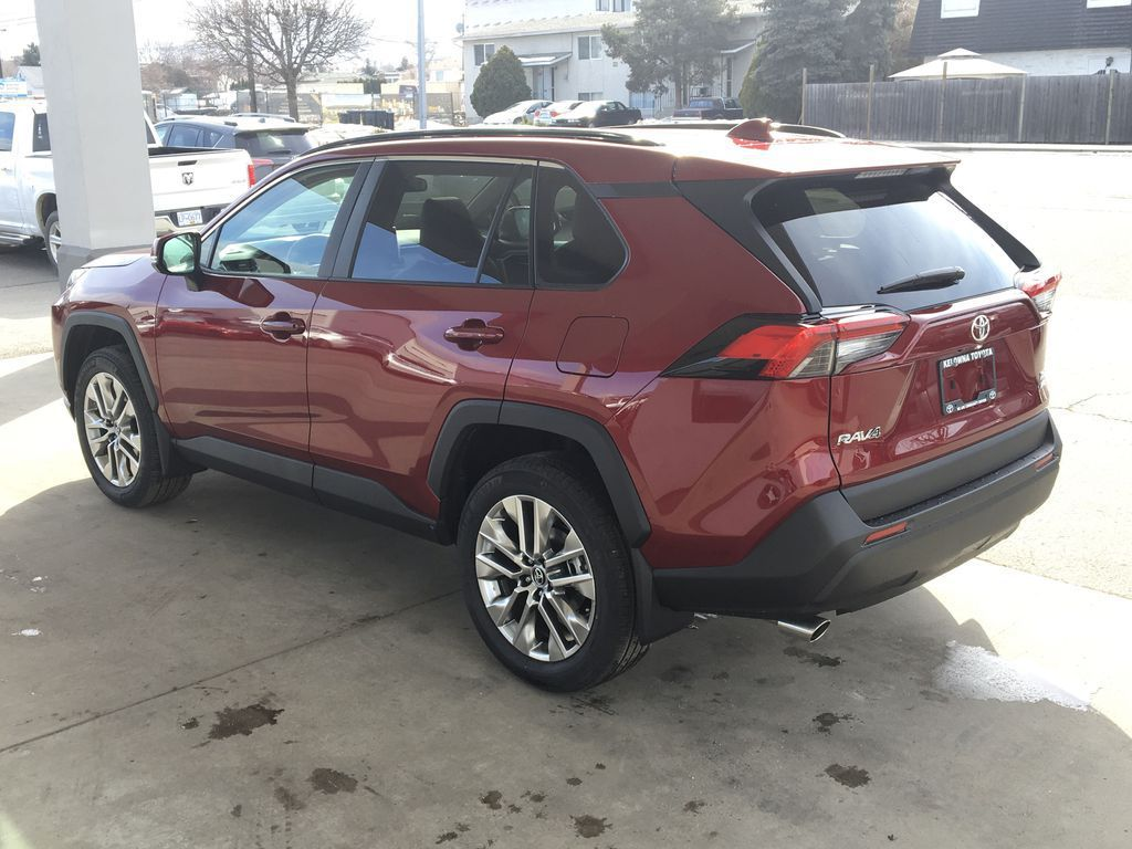 Red[Ruby Flare Pearl] 2021 Toyota RAV4 XLE Premium Left Rear Corner Photo in Kelowna BC
