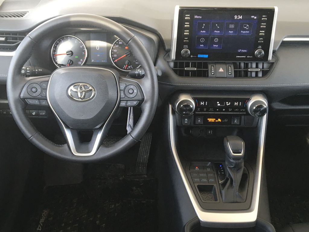 Red[Ruby Flare Pearl] 2021 Toyota RAV4 XLE Premium Steering Wheel and Dash Photo in Kelowna BC