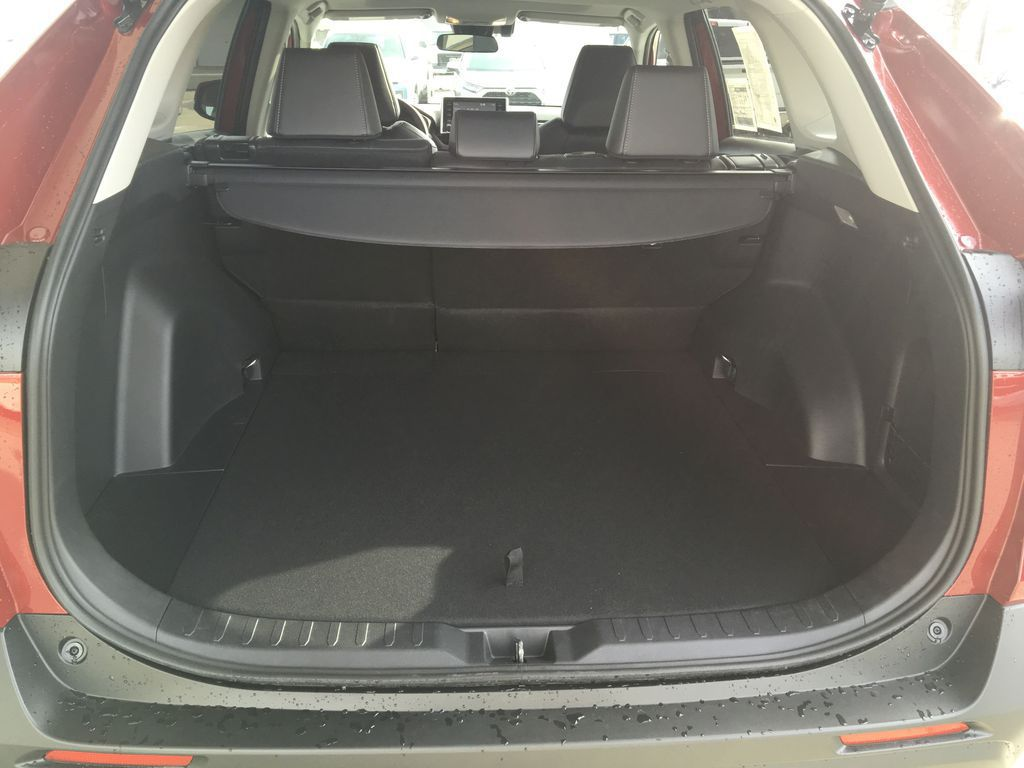Red[Ruby Flare Pearl] 2021 Toyota RAV4 XLE Premium Trunk / Cargo Area Photo in Kelowna BC