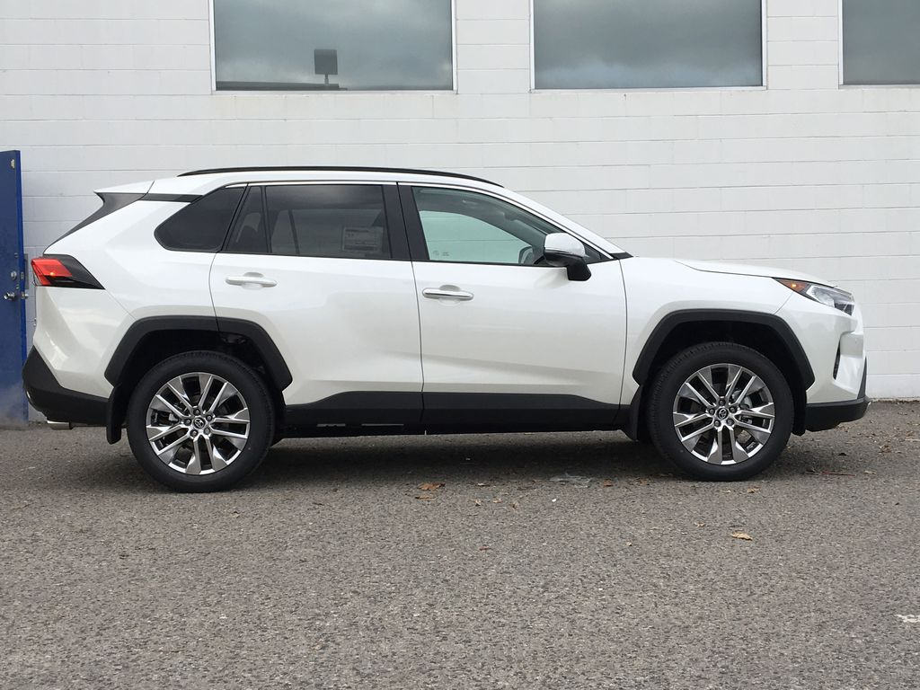 White[Blizzard Pearl] 2021 Toyota RAV4 Limited Right Side Photo in Kelowna BC