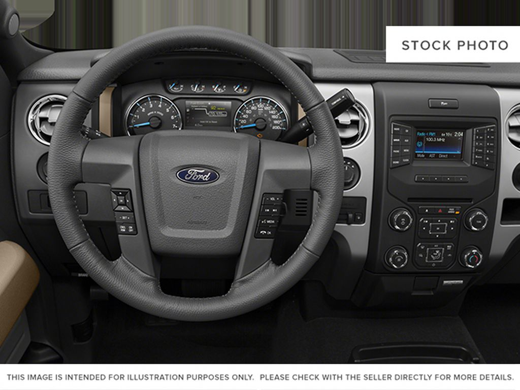 Red[Race Red] 2014 Ford F-150 Steering Wheel and Dash Photo in Fort Macleod AB