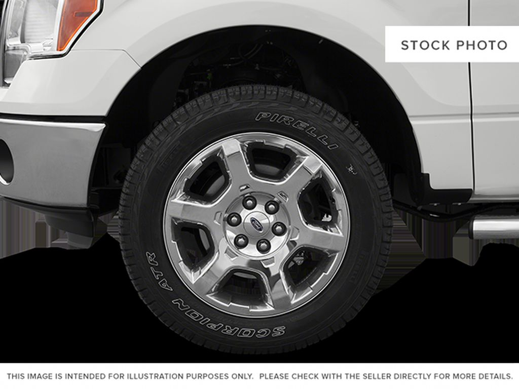 Red[Race Red] 2014 Ford F-150 Left Front Rim and Tire Photo in Fort Macleod AB