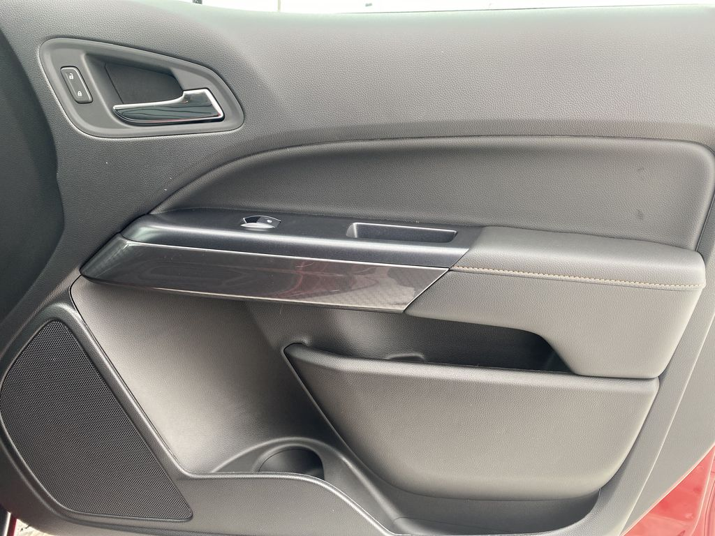 Red[Cayenne Red Tintcoat] 2021 GMC Canyon Right Front Interior Door Panel Photo in Edmonton AB