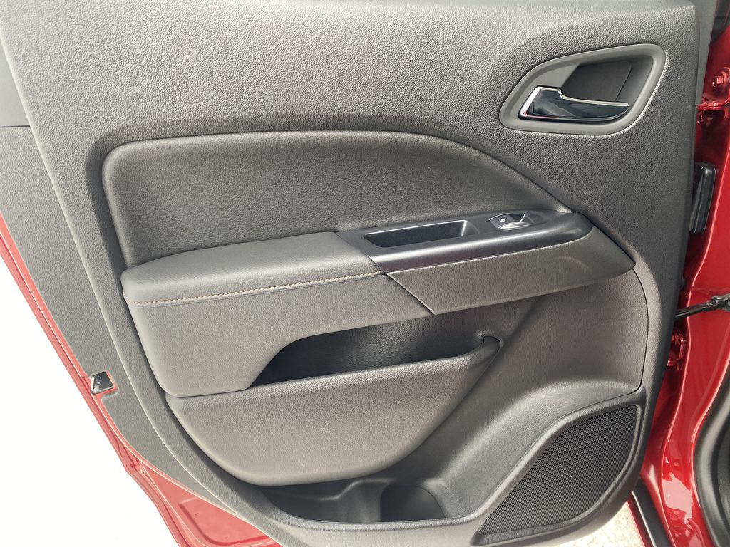 Red[Cayenne Red Tintcoat] 2021 GMC Canyon Left Rear Interior Door Panel Photo in Edmonton AB