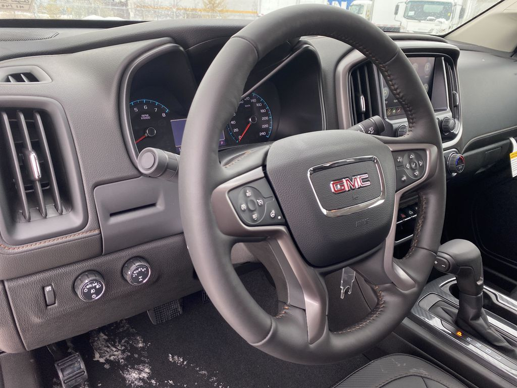 Red[Cayenne Red Tintcoat] 2021 GMC Canyon Steering Wheel and Dash Photo in Edmonton AB