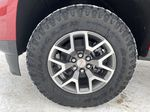 Red[Cayenne Red Tintcoat] 2021 GMC Canyon Left Front Rim and Tire Photo in Edmonton AB