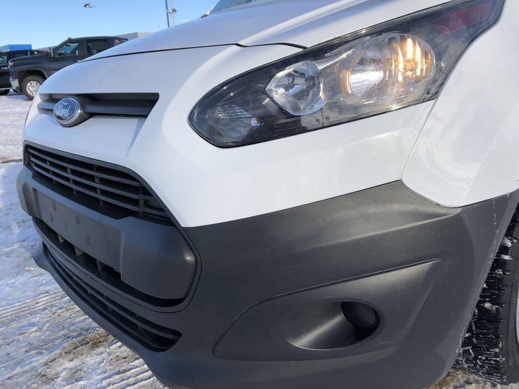 White[Frozen White] 2015 Ford Transit Connect Left Front Head Light / Bumper and Grill in Edmonton AB