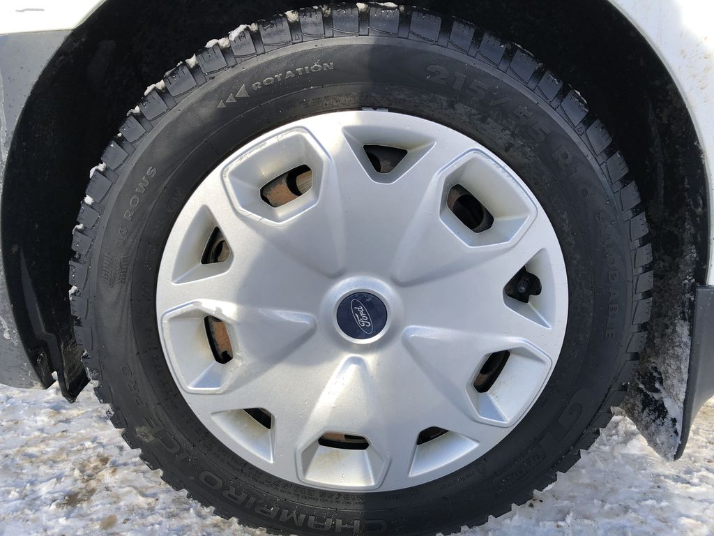 White[Frozen White] 2015 Ford Transit Connect Left Front Rim and Tire Photo in Edmonton AB