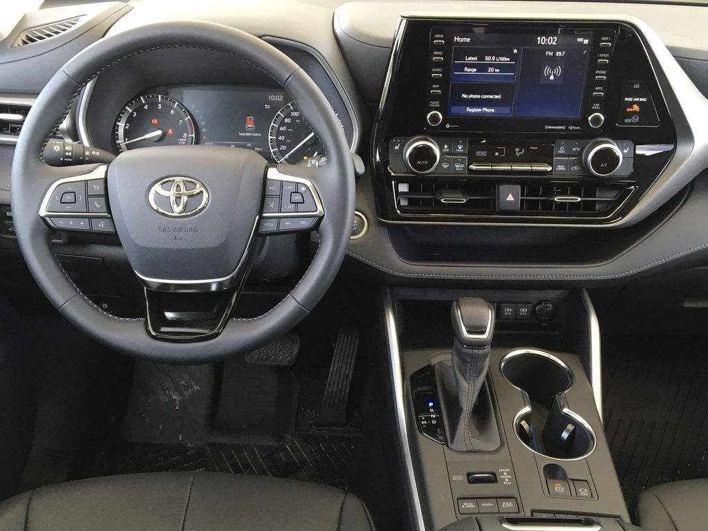 Red[Ruby Flare Pearl] 2020 Toyota Highlander XLE Steering Wheel and Dash Photo in Kelowna BC