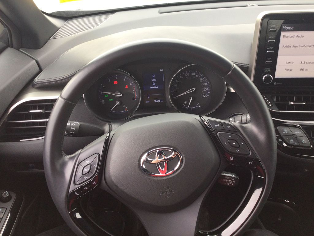 Gray[Magnetic Grey Metallic] 2019 Toyota C-HR Steering Wheel and Dash Photo in Brockville ON