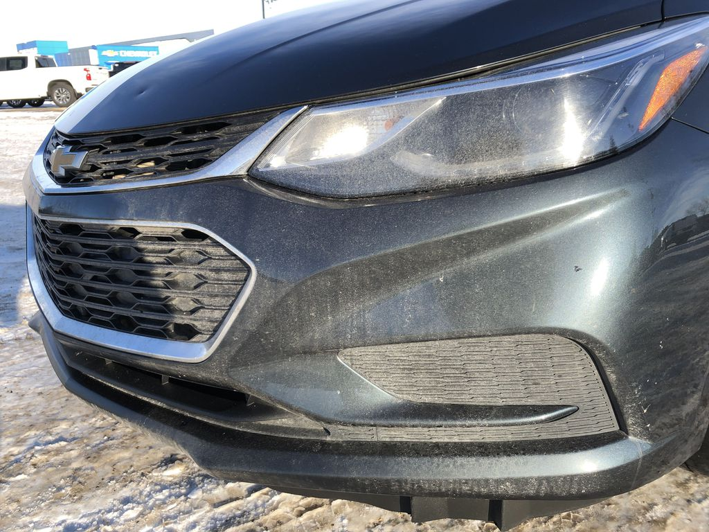 Gray[Graphite Metallic] 2017 Chevrolet Cruze Left Front Head Light / Bumper and Grill in Edmonton AB