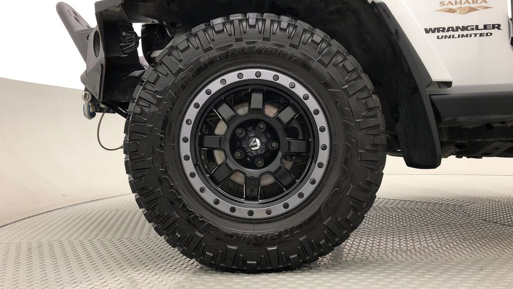 White[Bright White] Lifted 2013 Jeep Wrangler Unlimited Sahara - Leather, NAV, WARN Winch Left Front Rim and Tire Photo in Winnipeg MB