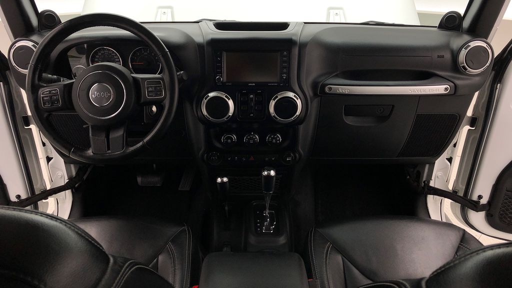 White[Bright White] Lifted 2013 Jeep Wrangler Unlimited Sahara - Leather, NAV, WARN Winch Central Dash Options Photo in Winnipeg MB