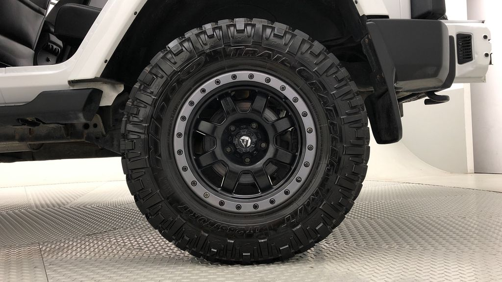White[Bright White] Lifted 2013 Jeep Wrangler Unlimited Sahara - Leather, NAV, WARN Winch Left Rear Rim and Tire Photo in Winnipeg MB
