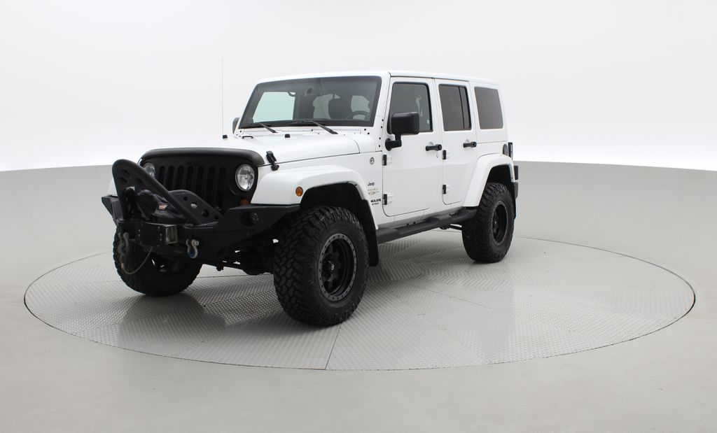 White[Bright White] Lifted 2013 Jeep Wrangler Unlimited Sahara - Leather, NAV, WARN Winch Left Front Corner Photo in Winnipeg MB