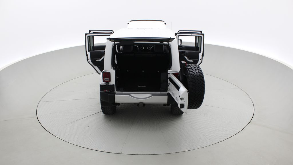 White[Bright White] Lifted 2013 Jeep Wrangler Unlimited Sahara - Leather, NAV, WARN Winch Rear of Vehicle Photo in Winnipeg MB