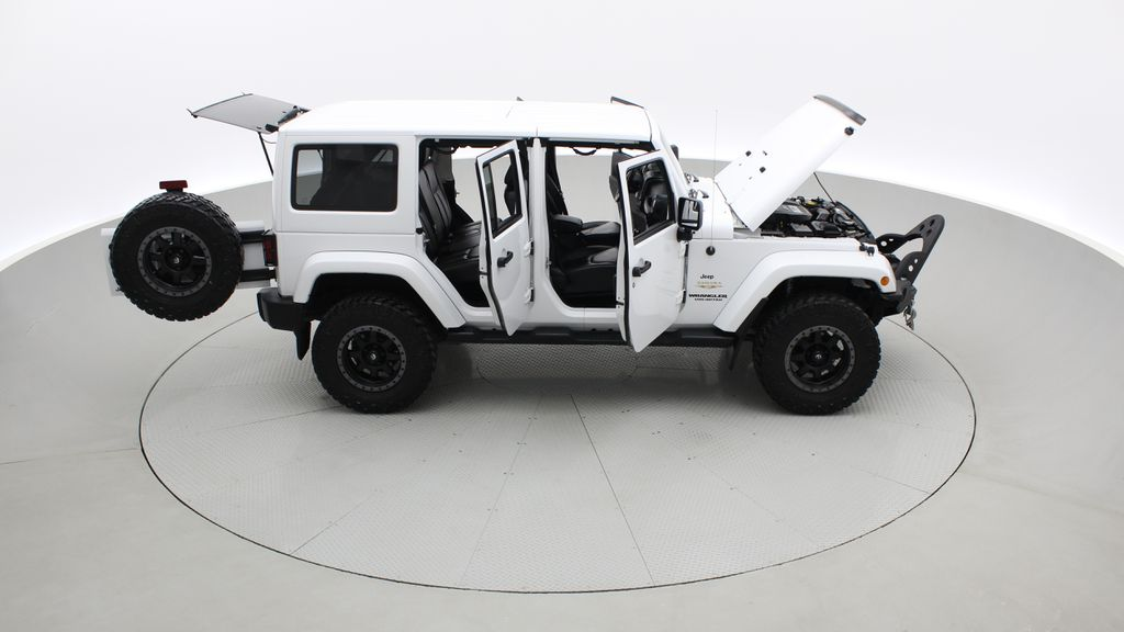 White[Bright White] Lifted 2013 Jeep Wrangler Unlimited Sahara - Leather, NAV, WARN Winch Right Side Photo in Winnipeg MB