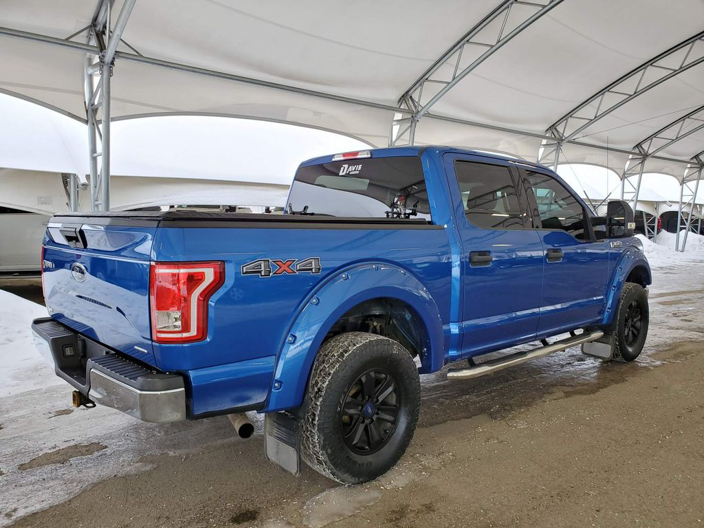 Blue 2015 Ford F-150 Right Rear Interior Door Panel Photo in Airdrie AB
