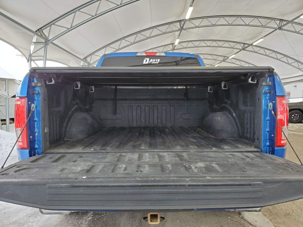 Blue 2015 Ford F-150 Right Rear Corner Photo in Airdrie AB