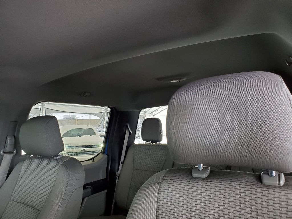 Blue 2015 Ford F-150 Driver's Side Door Controls Photo in Airdrie AB