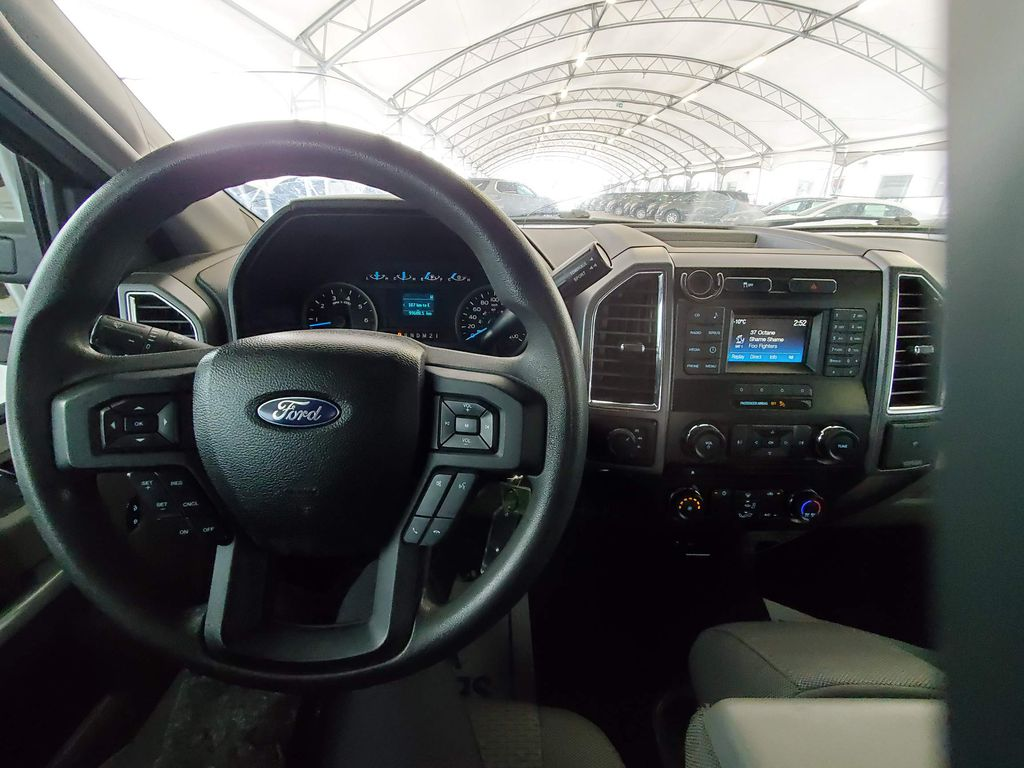 Blue 2015 Ford F-150 Left Side Photo in Airdrie AB