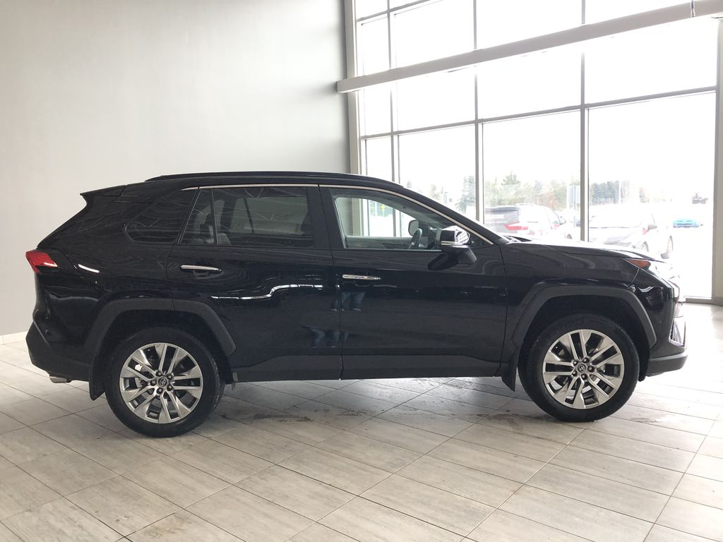 Black 2019 Toyota RAV4 Limited | Toyota Certified Right Rear Corner Photo in Edmonton AB