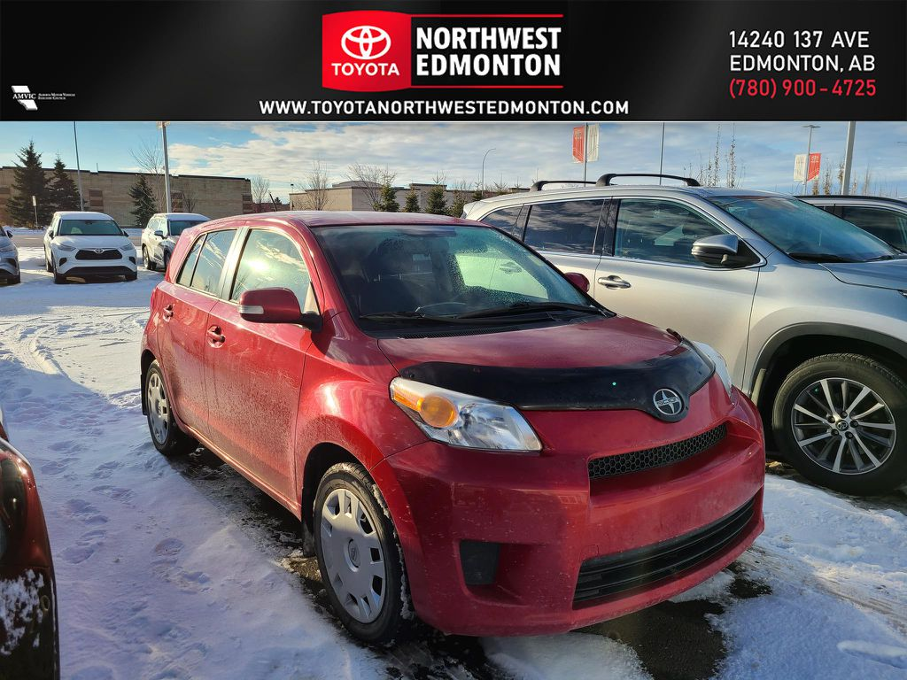 Red 2011 Scion xD 5DR HB MAN