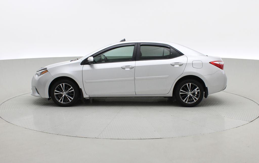 Silver[Classic Silver Metallic] 2016 Toyota Corolla LE - AUTO, Sunroof, 2 Sets Of Wheels, LOW PRICE Left Side Photo in Winnipeg MB