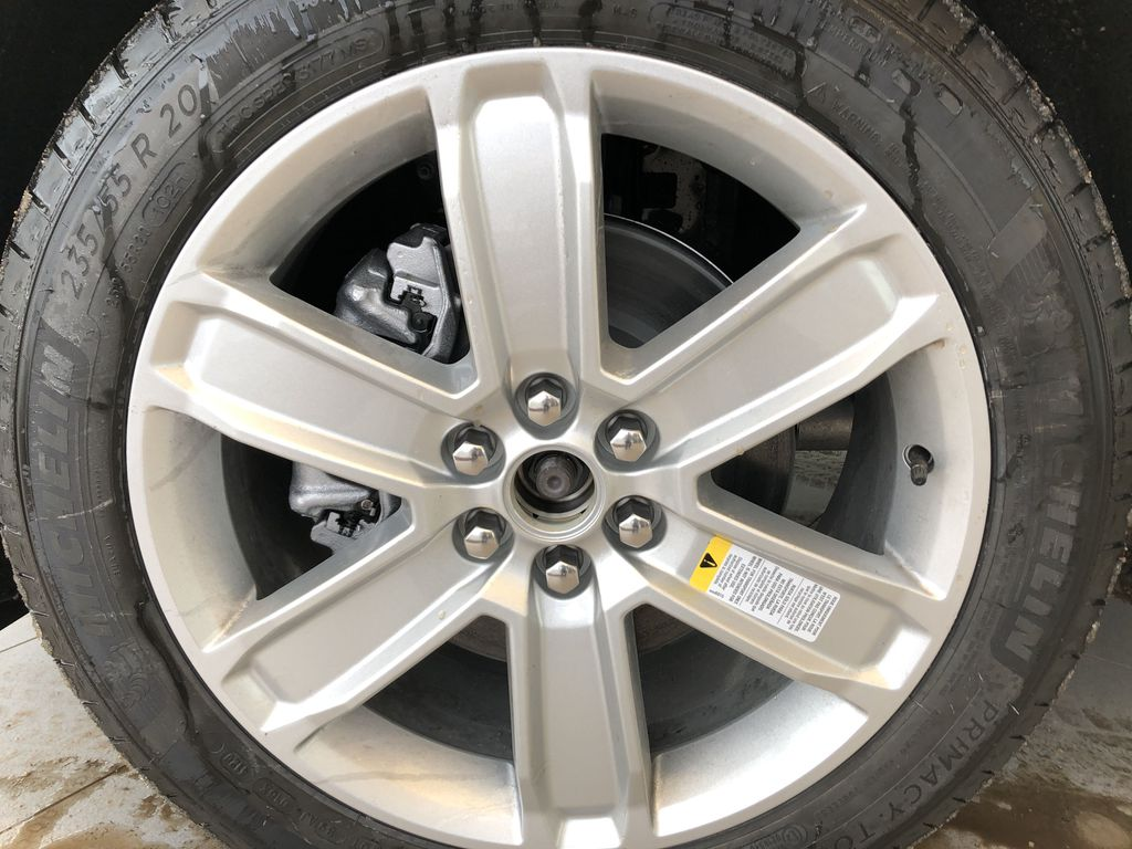 Black[Stellar Black Metallic] 2021 Cadillac XT5 Left Front Rim and Tire Photo in Edmonton AB