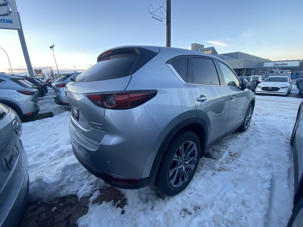SONIC SILVER METALLIC(45P) 2021 Mazda CX-5 Signature AWD  Driver's Side Door Controls Photo in Edmonton AB