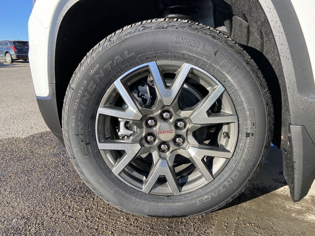 White[Summit White] 2021 GMC Acadia SLE Left Front Rim and Tire Photo in Calgary AB